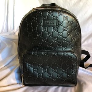 Gucci Signature Leather Backpack.